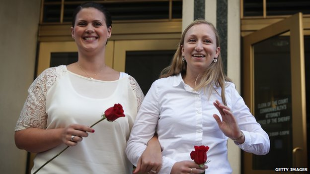 Two women emerge from a Virginia courthouse after getting married on 6 October, 2014.