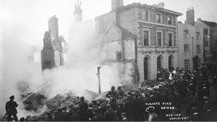 Firemen at blaze at Dusart's shop in 1904