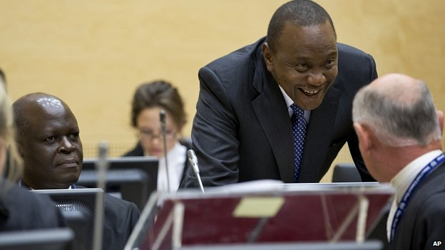 Uhuru Kenyatta talks to lawyers at ICC. 8 Oct 2014