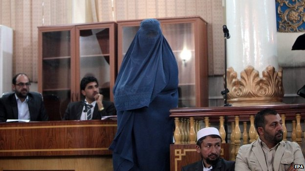One of four female victims of a gang-rape attends a court hearing in Kabul, Afghanistan, 07 September 2014.