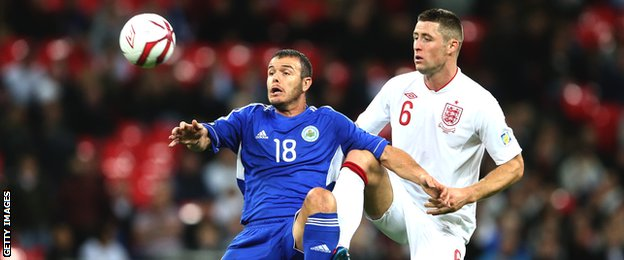 San Marino captain Andy Selva competes for the ball with England defender Gary Cahill during their World Cup qualifier at Wembley in 2012