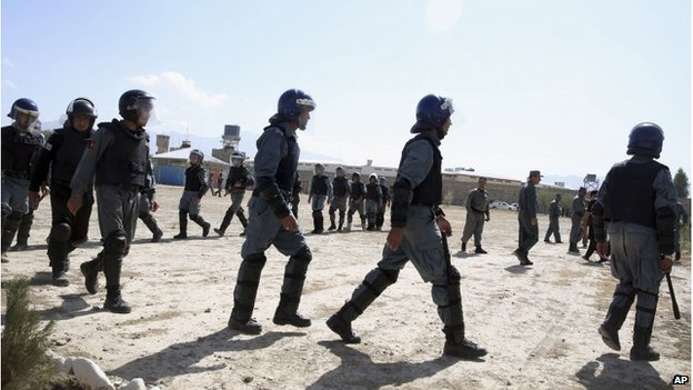 Afghan police officers take positions before the execution of six men sentenced to death at a jail in Kabul, Afghanistan, Wednesday, Oct. 8, 2014.