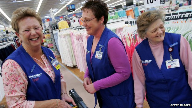 Three Wal-Mart employees stand in the clothing department of an Ohio store.