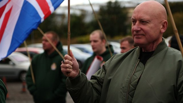 Britain First supporter holding union jack