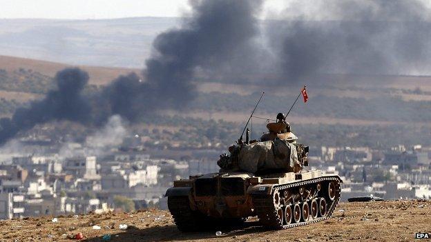 Turkish tank overlooks Kobane from across the border. 8 Oct 2014