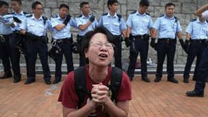 A student protester gets emotional while pleading for a peaceful resolution (2 Oct 2014)
