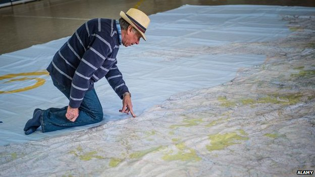 Man on a giant Ordnance map