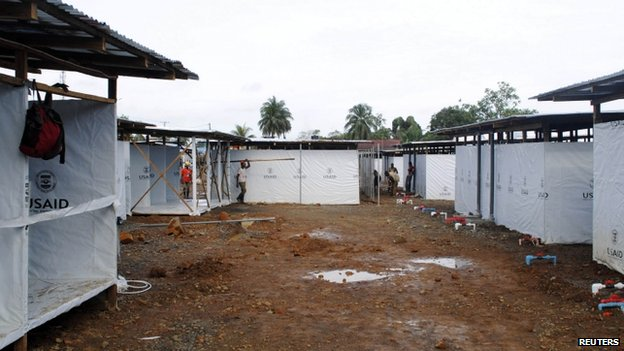Workers put the finishing touches to an Ebola virus treatment centre in Monrovia, Liberia. Photo: 9 October 2014