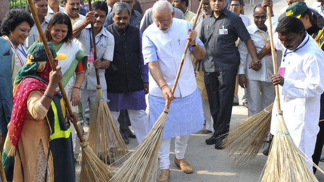 Indian Prime Minister Narendra Modi with a broom