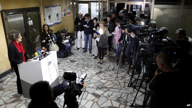 Jovanka Kostovska, left, of the Macedonian Health Ministry, speaks to the media during a news conference