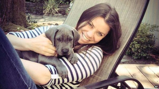 Brittany Maynard poses with a dog.