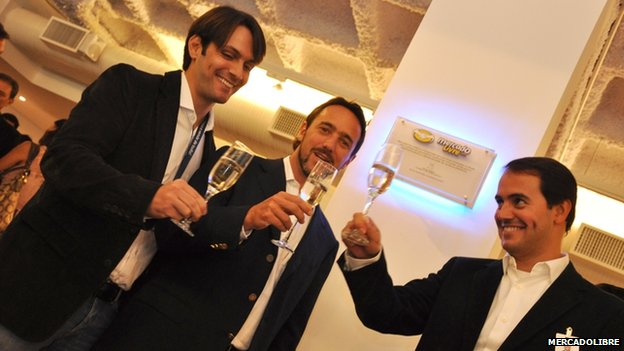Marcos Galperin and colleague toast the launch of the firm's new Sao Paulo office in 2011