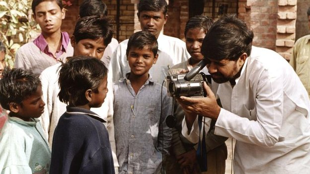 File picture from 1996 of Kailash Satyarthi shooting a video