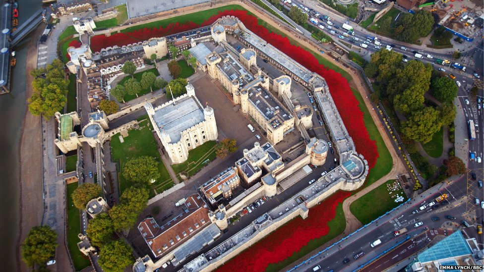 Ceramic poppies representing the people who died during World War One 'planted' in the Tower of London moat, seen from the London Air Ambulance