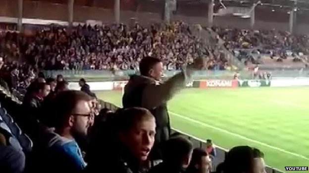 Fans chant at the Ukraine-Belarus Euro 2016 match in Borisov, Belarus, on 9 October 2014