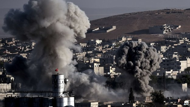 Smoke rises after strikes from the US-led coalition in the Syrian town of Kobane on 10 October 2014.