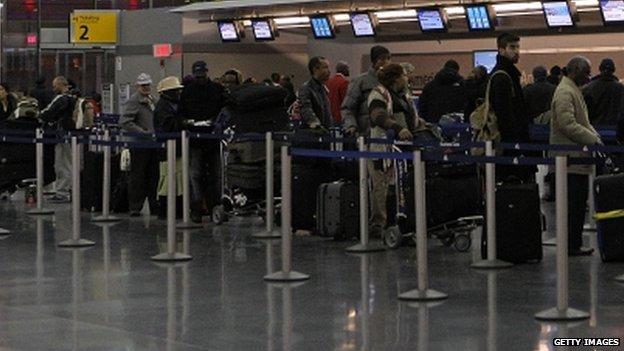Passengers at JFK airport. File photo