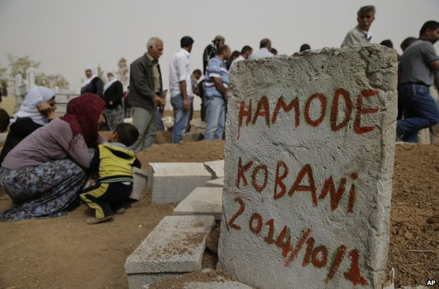 The gravestone of a Kurdish fighter buried near the Turkish town of Suruc, across the border from Kobane, 11 October