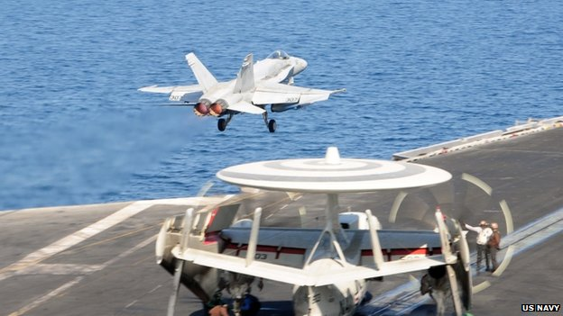 An F/A-18C Hornet leaves the flight deck of the aircraft carrier USS George HW Bush in The Gulf, 10 October