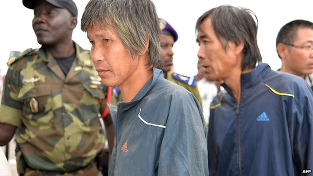Chinese hostages, who were released after being kidnapped in raids blamed on the Nigerian Islamist group Boko Haram, arrive in Yaounde on 11 October 2014.