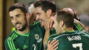 Northern Ireland players congratulate Kyle Lafferty on his 11th international goal