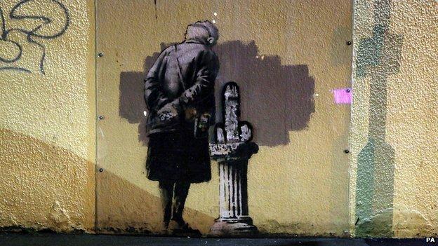 Defaced Banksy image