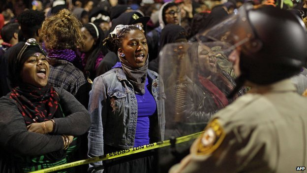 Protesters and police in Ferguson