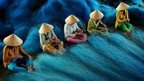 People mend nets