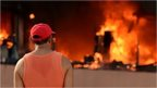 A man stares at the blazing Municipal Palace in Chilpancingo