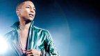 US singer Pharrell Williams performs in Amsterdam, September 2014.