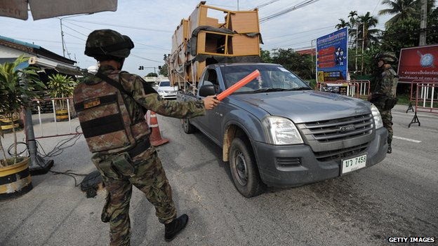 Thai soldier stopping a car