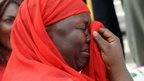 One of the mothers of the missing Chibok school girls wipes her tears as she cries during a rally by civil society groups pressing for the release of the girls in Abuja on 6 May 2014
