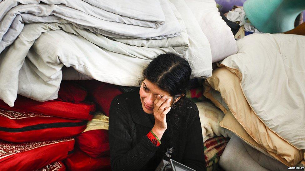 A Kashmiri woman in a make-shift shelter