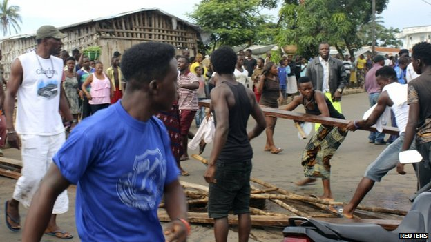 Road blocks in Freetown, Sierra Leone, to demand removal of bodies infected with Ebola