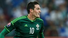 Kyle Lafferty runs to celebrate after scoring Northern Ireland's second goal in the 2-0 win in Greece