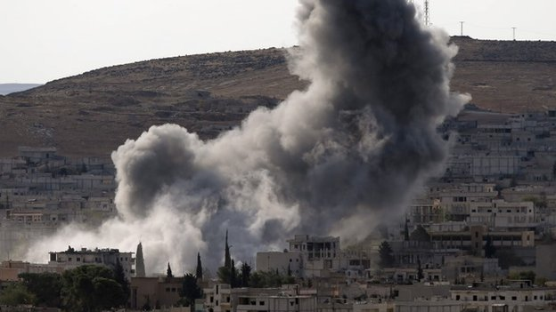 Smoke rises from the Syrian town of Kobane after an air strike on 15 October 2014