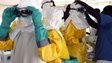 Medical staff adjust their protection suits in Monrovia, Liberia on 27 September 2014