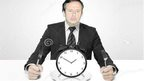 """Jorge """"Tuto"""" Quiroga about to eat a clock"""
