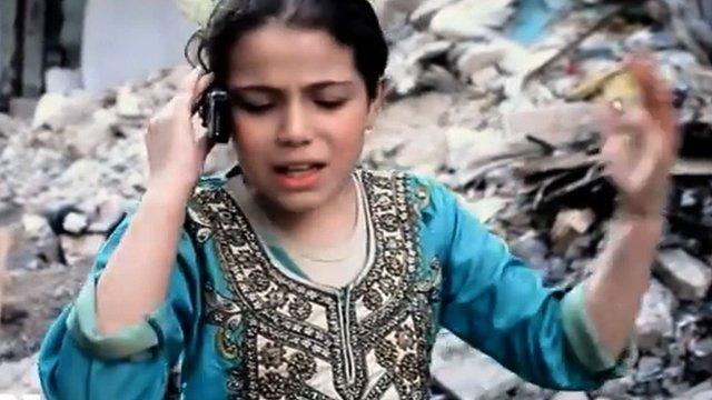"""Nine-year old Rasha talking on a phone in """"Umm Abduh"""""""