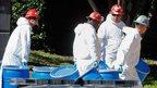 Workers decontaminate nurse's flat
