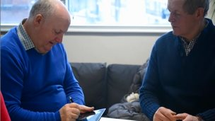 Tommy Dunne (left) who is living with dementia uses an application developed by the Innovate Dementia project