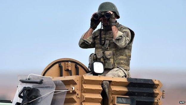 Turkish soldier watching events in Kobane