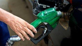 driver filling a petrol tank