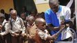 Nigerian pupils wash their hands as  in Abuja, Nigeria on 15 October 2014