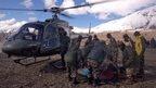 Injured survivor with Nepalese army