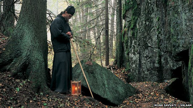 Monk in a forest