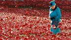 Britain's Queen Elizabeth at a Tower of London art installation featuring thousands of ceramic poppies