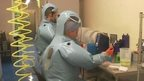 Lab workers in protective clothing