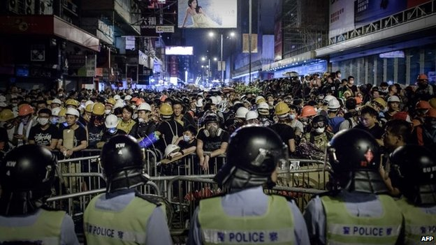 Pro-democracy protesters stand their ground in the Mong Kok district of Hong Kong, 19 October 2014