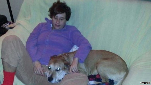 Teresa Romero Ramos, the Spanish nurse who contracted Ebola, is pictured with her dog Excalibur in this undated handout photo provided on 8 October 2014
